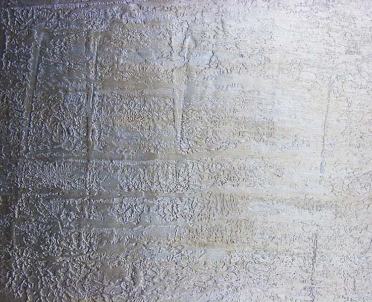 Distressed, texured wall tile, developed by our team of decorative plasterers for a contract in the Middle East.