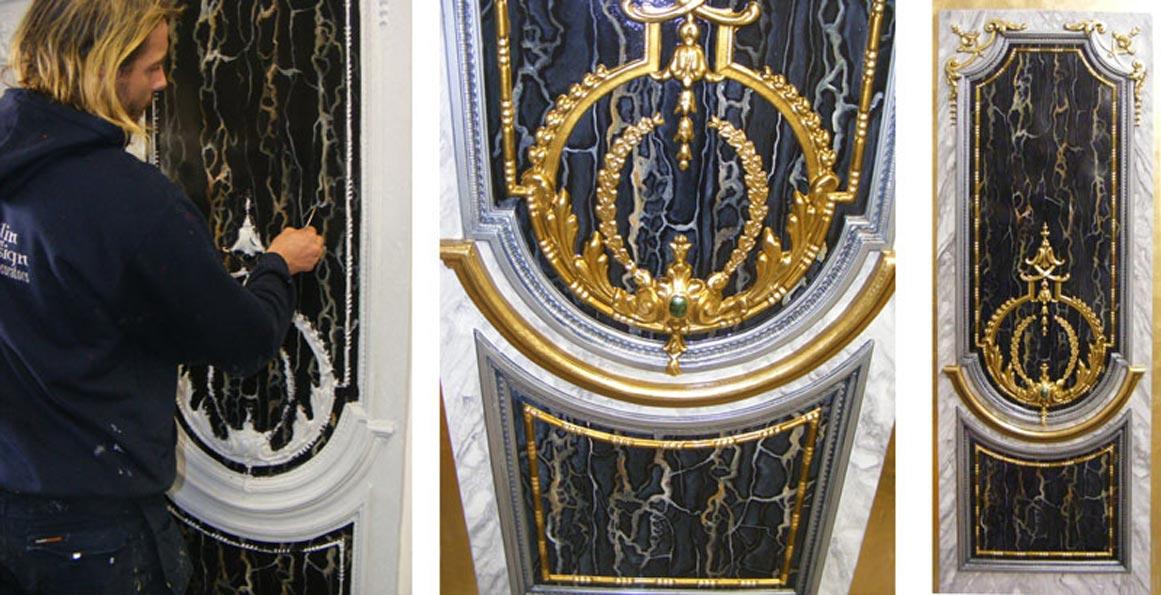 Portoro marble panel adorned with gold leaf moulding and semi precious decorative stone.