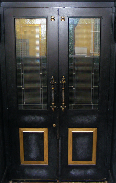 The entrance doors to The Cock Tavern in Swords were treated an old grey slate hand painted finish. The door panels were gilded in 24ct gold. The door handles were treated with a distressed paint effect and an antique gold paint finish.
