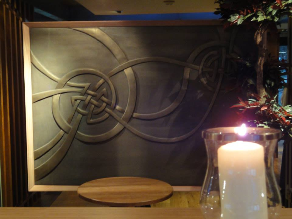 The hand sculpted celtic wall installation was designed and created by interior designer Graham Barrow. The bronze paint effect and gilded carving was carried out by Devlin In Designs artisans.