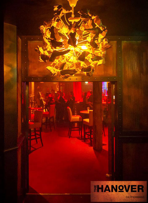 The faux rusted walls and columns were hand painted by our specialist decorators at Devlin In Design. The metallic bronze and studded wall surrounds compliment the entrance to the nightclub.