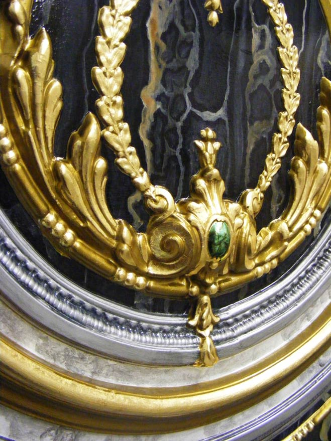 The highly decorative moulded panel was treated to a variety of specialist paint finishes. The panel received a fully restored makeover of gilding, distressed gold paint finish, marbling, and an emerald jewel paint finish.