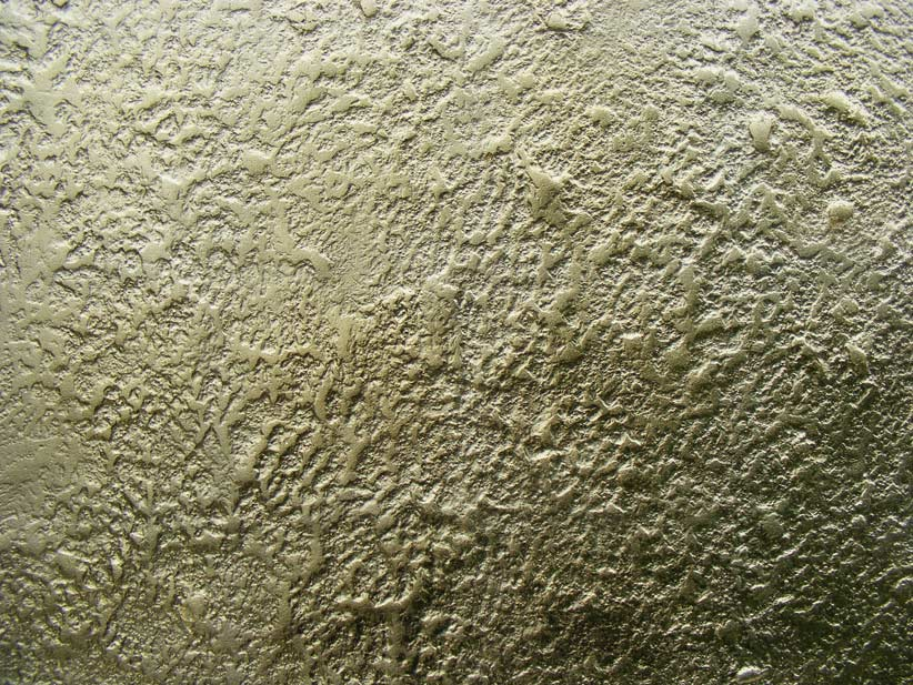 Distressed textured wall, hand crafted and painted in our own gold glazing medium, for the main feature wall to the hotel.