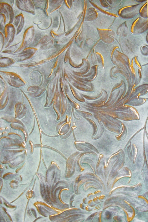 The heavy verdigris finish with gilded surface are part of a feature wall in a private residence. It was created over Lincrusta which is a heavily embossed wallpaper.
