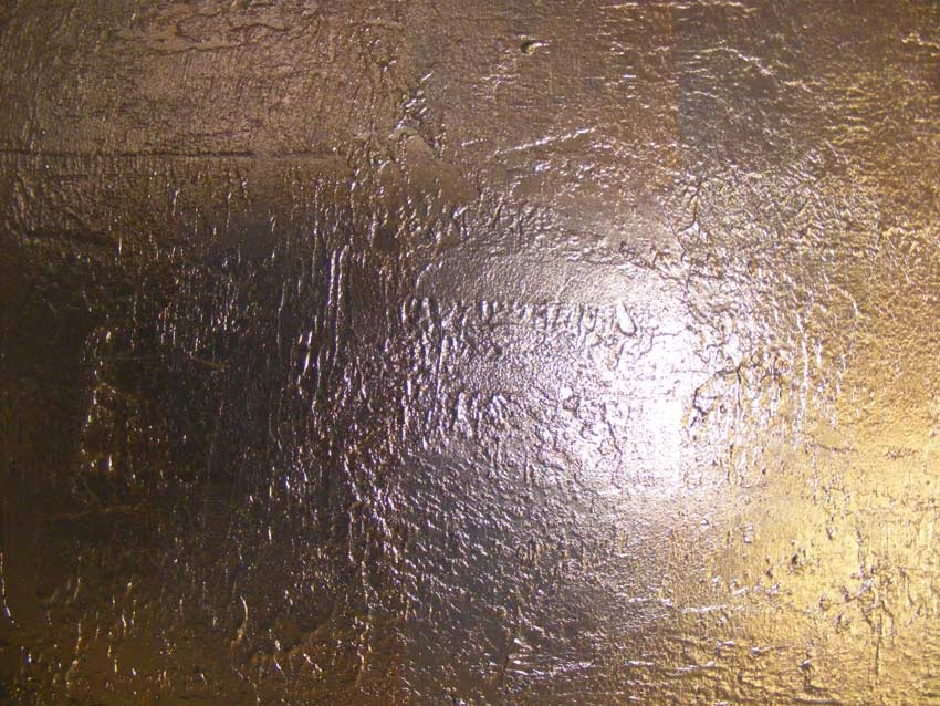 Feature wall treated with our very own bronze, gilded textured plaster effect. Due to client and designers requirements we produced this specific finish to adorne the walls in the foyer entrance.