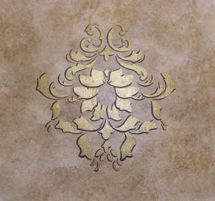 Faux stone wall effect was decorated with stencilling and a 24ct gold gilded inlay at a private residence.
