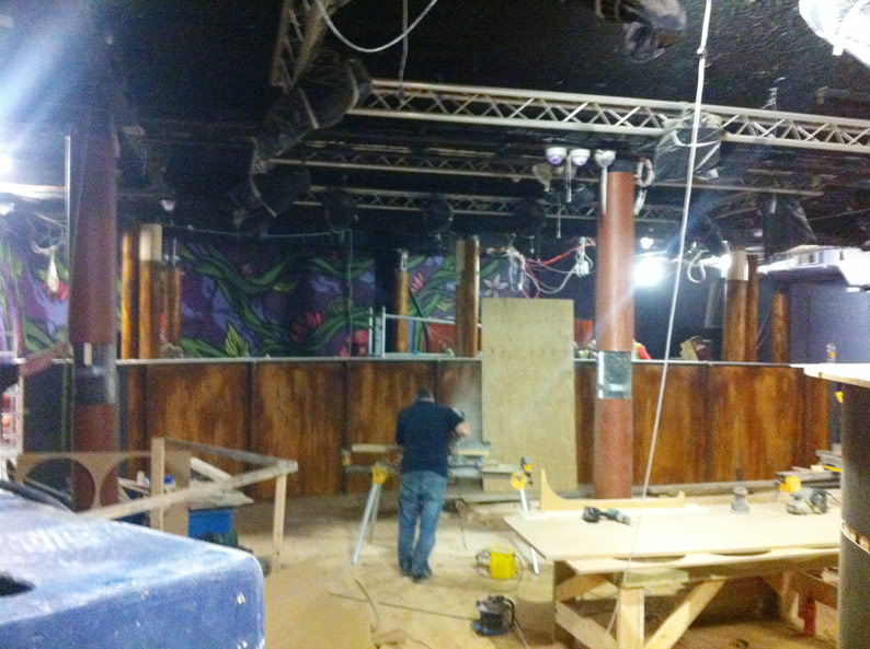 Creating the faux rust effect finish for the dance floor surround, at The Hannover Nightclub, Cork, Ireland.