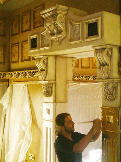 Ornate decorative mouldings with gold leaf gilded pillars and decorative hand painted corbels.