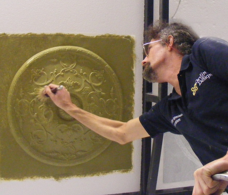 Prepairing a ceiling rose for it's decorative paint finish.