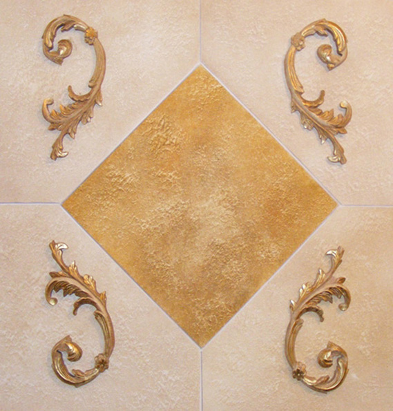 Faux stone block effect wall finish with gilded decorative moulding.