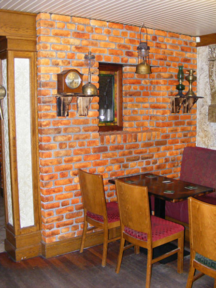 Hand painted faux old red brick finish, O'Neills Bar, Northern Ireland.