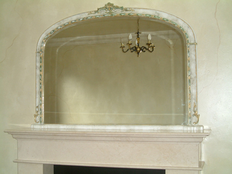 The faux finish on the walls add charachter to the decorative painting carried out on the mirror.