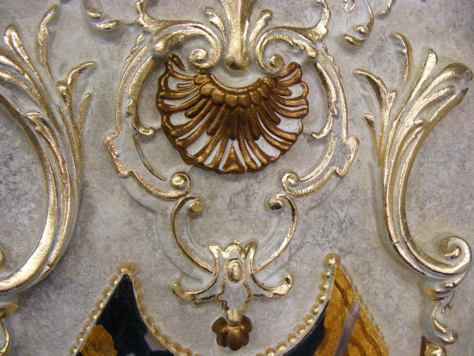 The decorative acanthus style moulds were faux finished with a metallic paint finish and faux stone effect. They were then gilded with dutch metal leaf.
