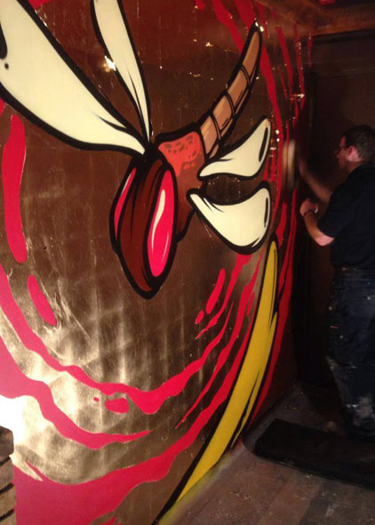 The wall was gilded in between the graffiti artwork and polished to a high sheen in the nightclub entrance.