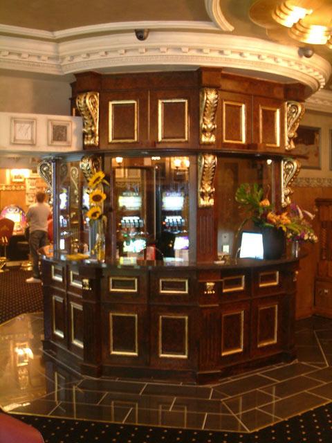 Woodgrained Kiosk with ornamental gilded panels.