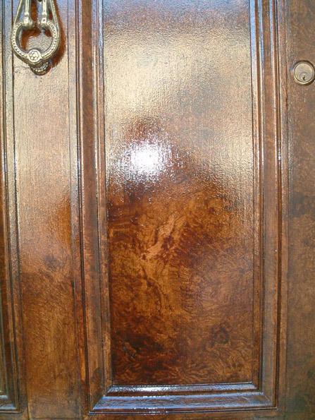 Walnut woodgrain restored front door way at Queen's University, Belfast, Northern Ireland.