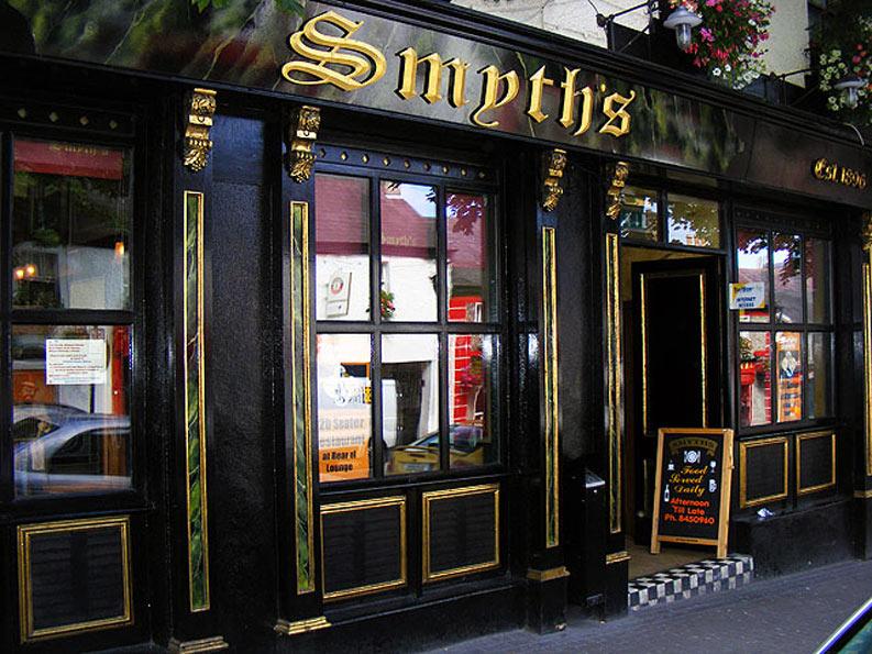 Green faux marble panels, with gold leaf gilded frames adorned with aged gold leaf corbels. Gold Leaf gilded bar front signage, Smyths Bar and Restaurant, Swords, Ireland.