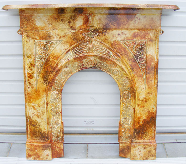 Fantasy faux marble antique fireplace and mantel, with decorative gilded moulding.