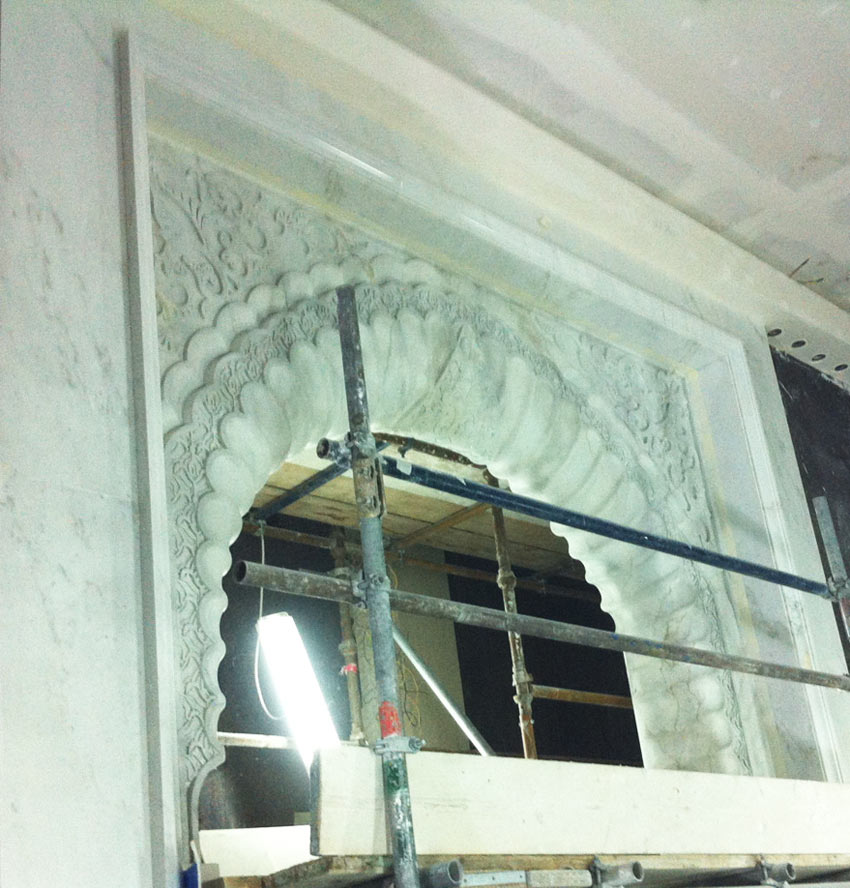 White Carrara faux marble archway, with faux stone decorative painted moulding. One of the faux marble and stone archways in the King of Qatar's Palace, in Qatar, Middle East, by Devlin in Design specialist decorators.