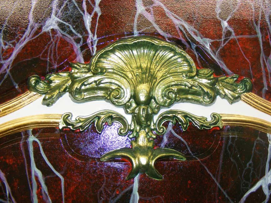 Red Lavanto faux marble finish with green gold ornate metallic inlay and gilded frame.