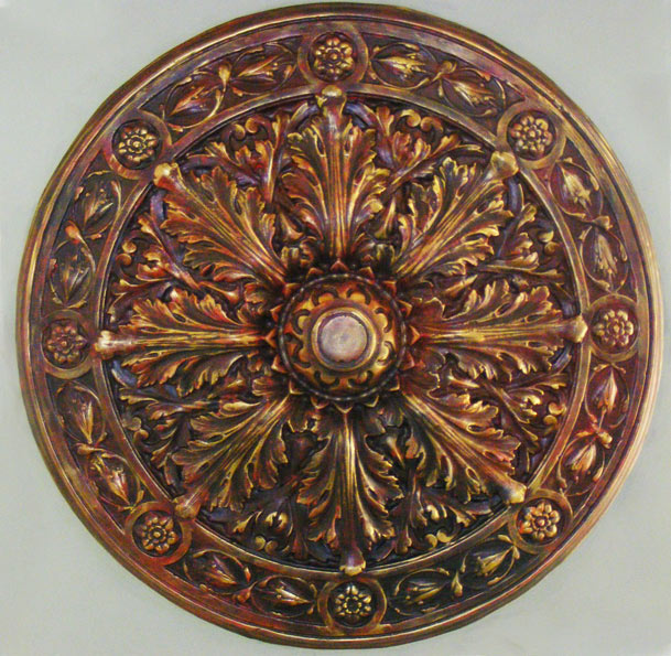 Ornate ceiling rose with hand painted faux finish and antique gold glaze, installed in a private residence in Paris, France.