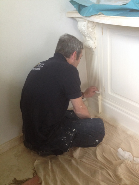 Our specialist decorator and decorative painter applying the antique glaze to the surface of the kitchen.