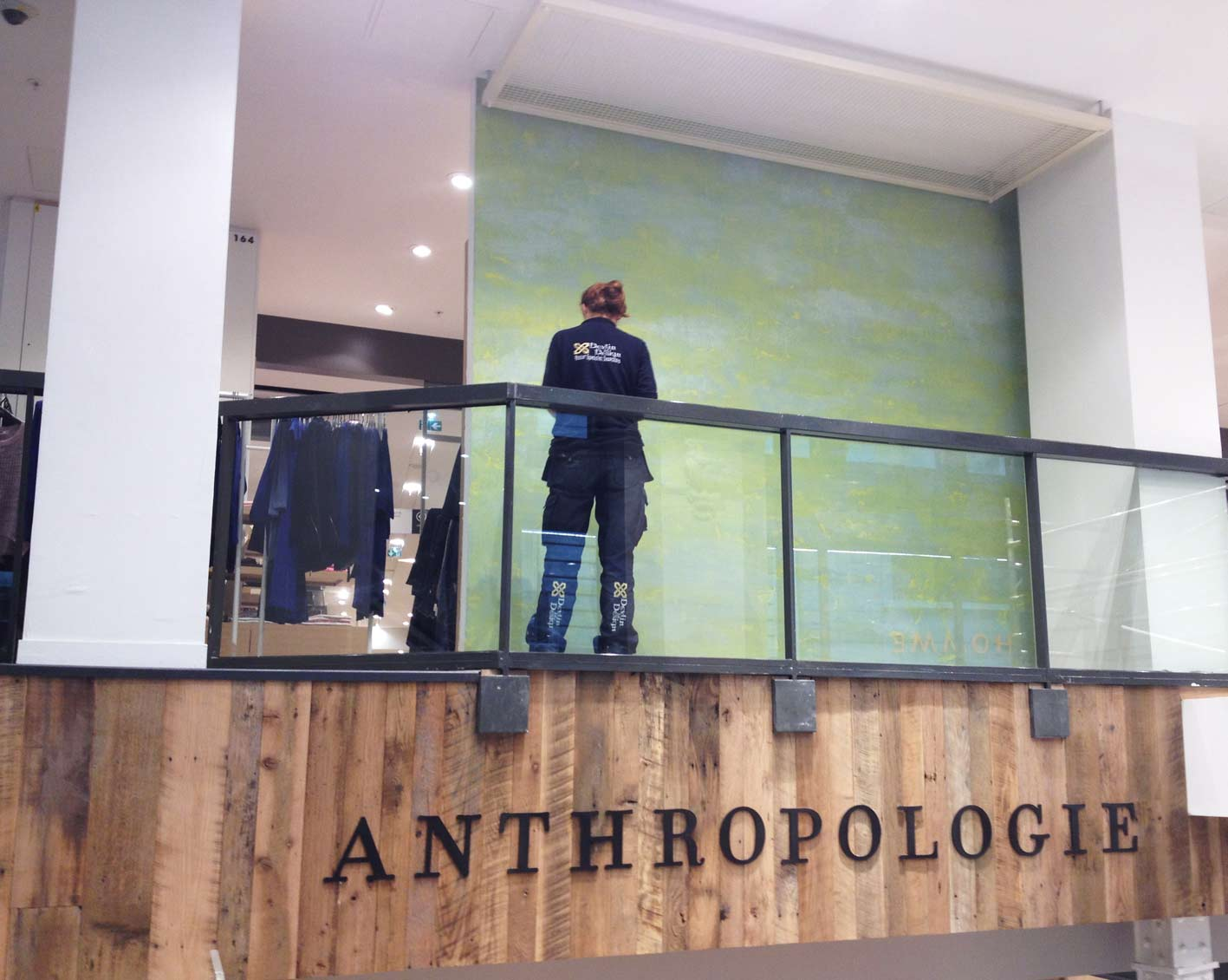 Devlin In Design decorative painting team created this distressed, hand painted plaster effect wall installation for the new Anthropologie store in Paris.