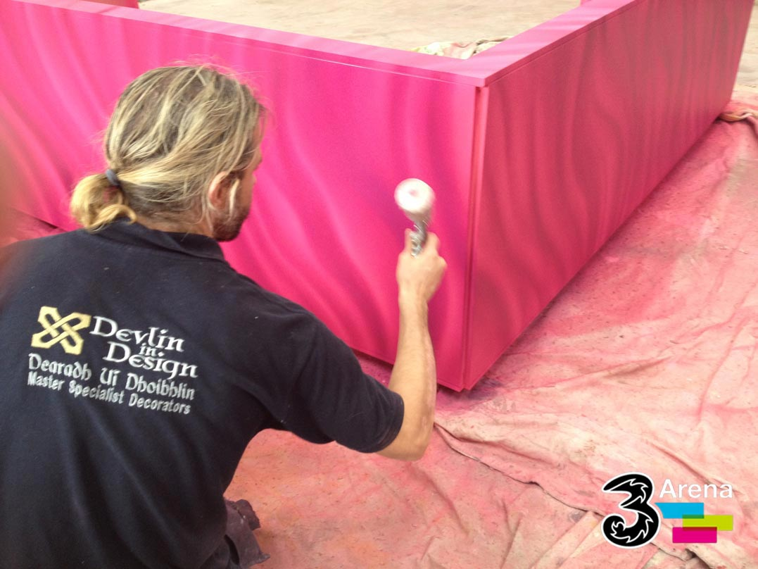 Creating a sprayed faux finish to decorate the seating and backing for the 3 Arena VIP Suite, in Dublin, Ireland.