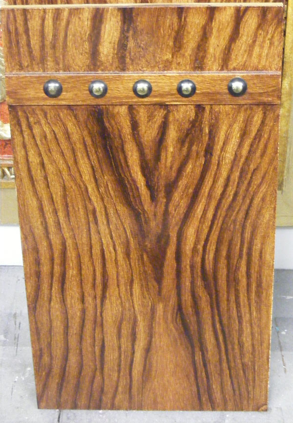 Fantasy Oak woodgrain panel  with decorative panel and vintage studs by Devlin in Design specialist decorators.