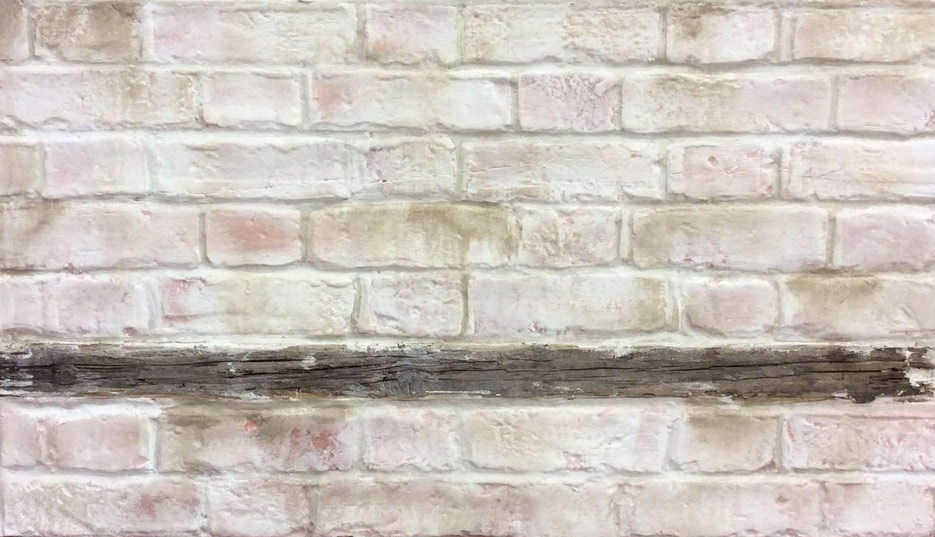 Lime washed faux brick wall, hand sculpted and painted by our decorative painters and sculptors. Aged and distressed wooden inlay, plaster and painted faux brick work, and lime wash finish.