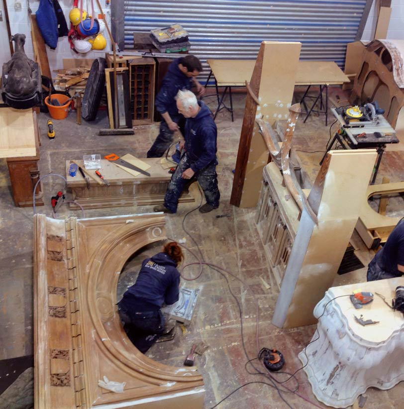 Our team of specialist decorators and sculptors working on the main body of the antique wall installation.