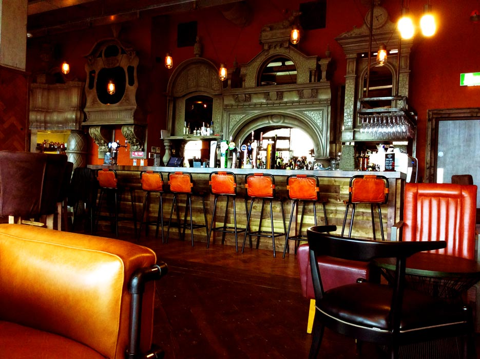 Ornate antique  bar surround and facade, created by Devlin In Design decorative painters, UK