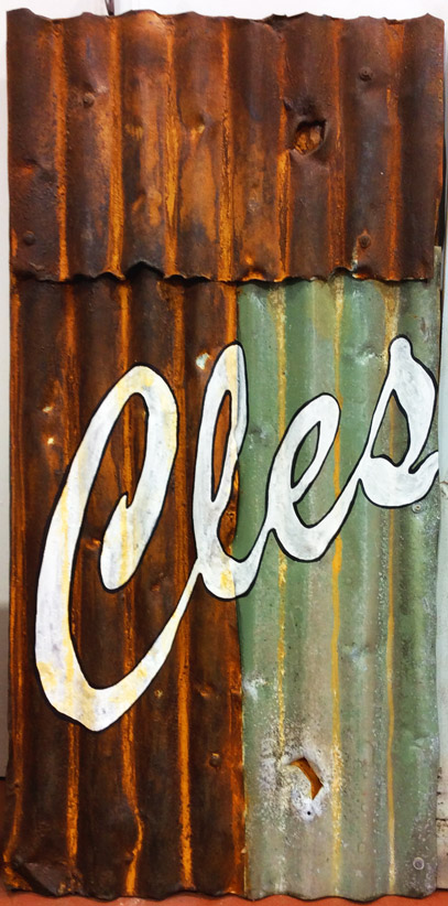 Faux rust panel, hand painted and decorated with signwriting, created by Devlin in Design specialist decorators.
