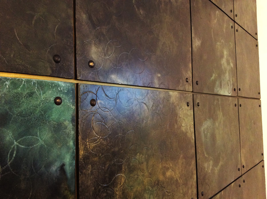 Decorative wall panels in bronze metal finish for private client in Paris, France