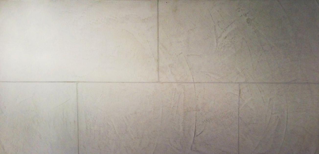 Stone blocking venetian plaster in restaurant interior walls.