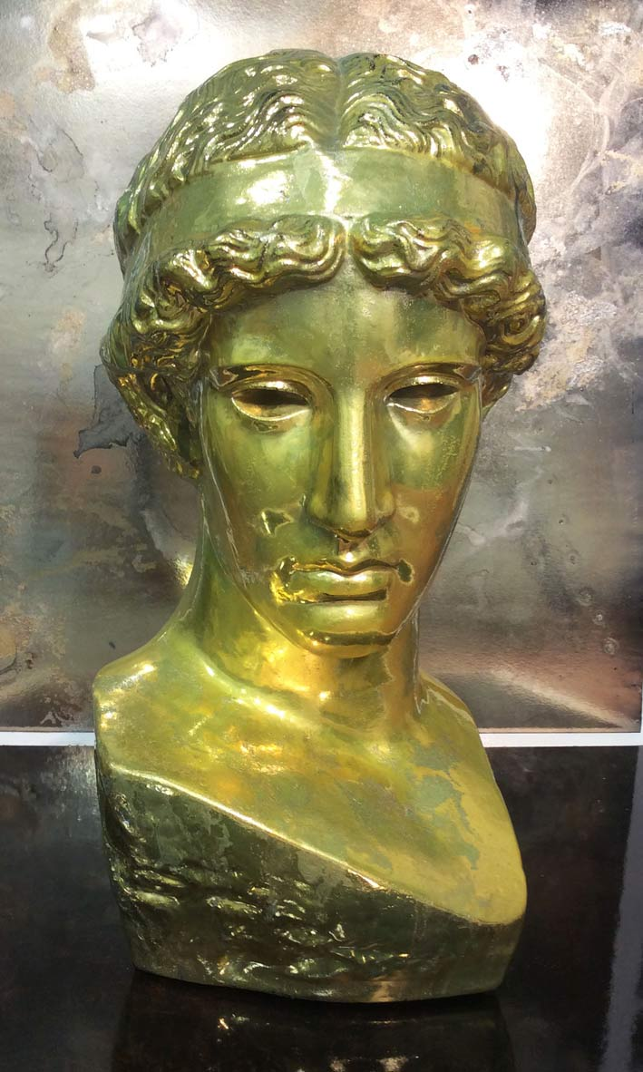 Distressed gold chrome bust.