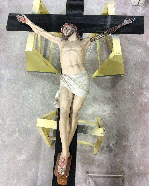 The detailed welded framework for the missing arm to Saint Mother Teresa's crucifix
