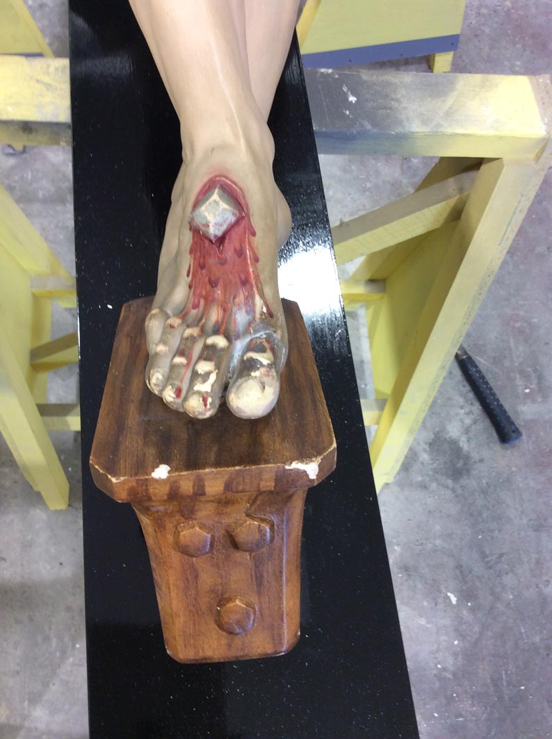 The bottom of the crucifix was also badly damaged prior to repair and restoration by Devlin In Design.