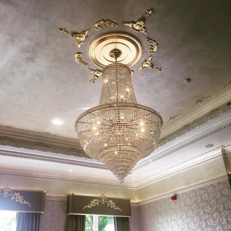 Hotel ceiling moulds designed, gilded, faux finished and gilded pelmets and polished plaster.