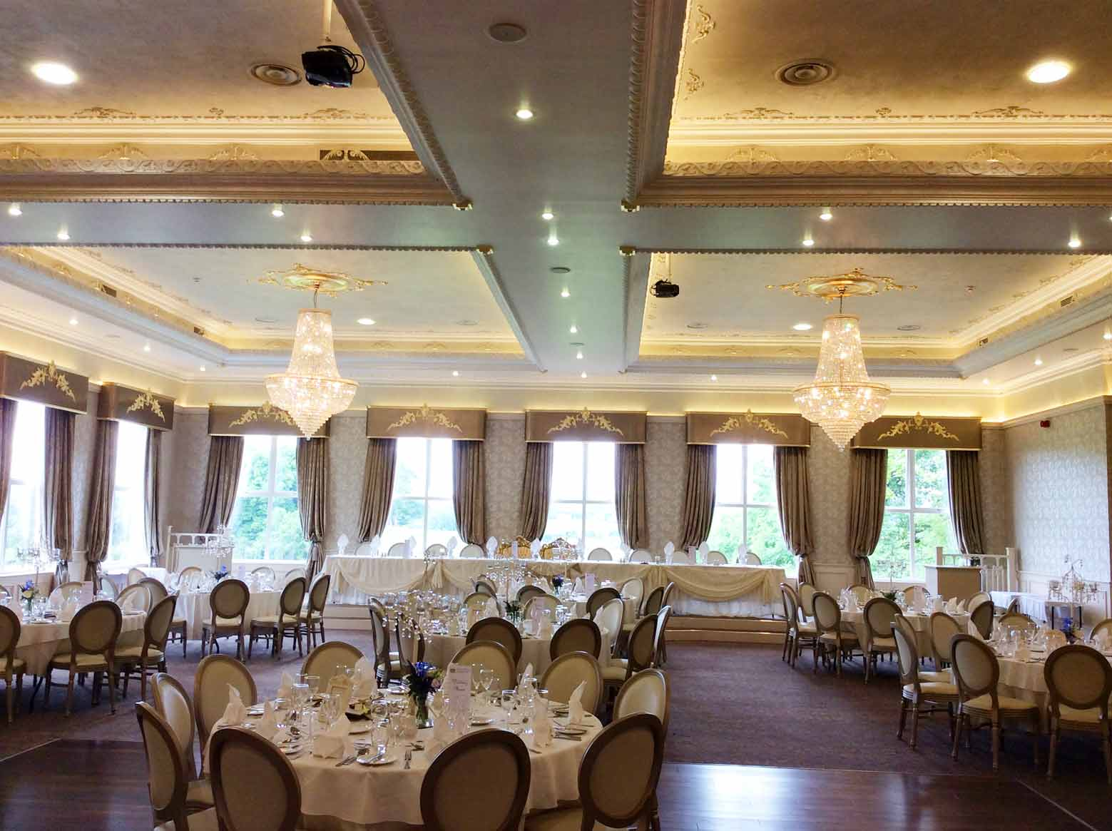 The hotel ceiling and pelmets were designed and constructed by our specialist decorators and decorative painters at Devlin In Design. We created an array of finishes on the ceiling including gilded mouldings, stucco and venetian plaster to create a beautiful wedding venue in Corick House Hotel and Spa.