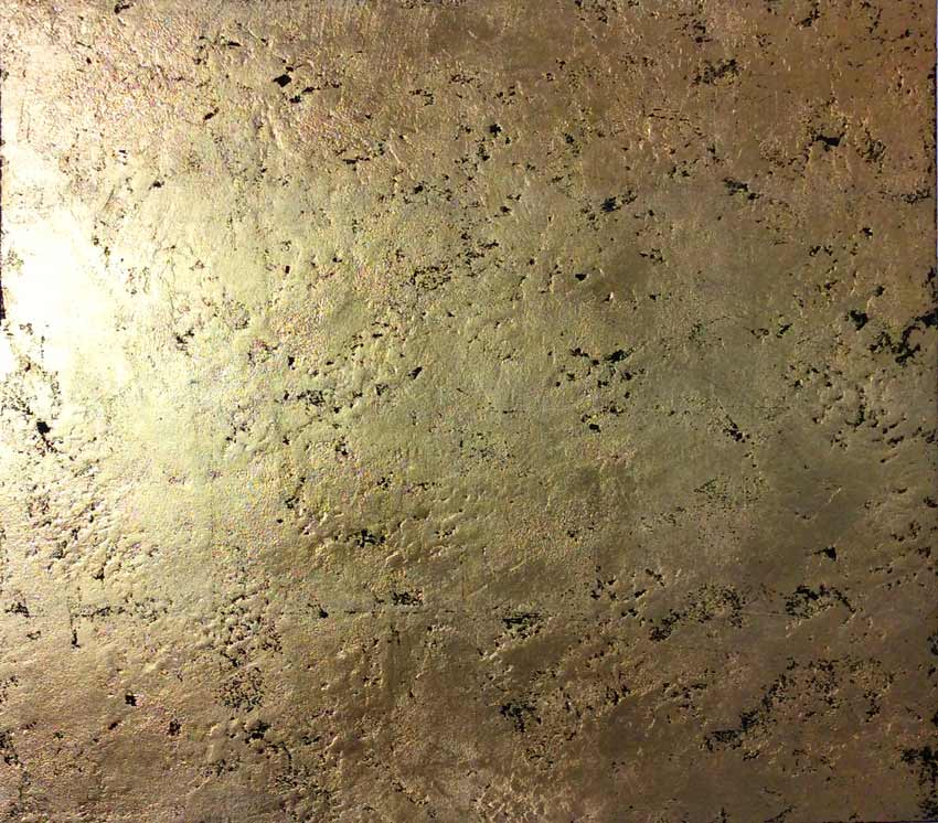 Rustic gold textured and pitted polished plaster