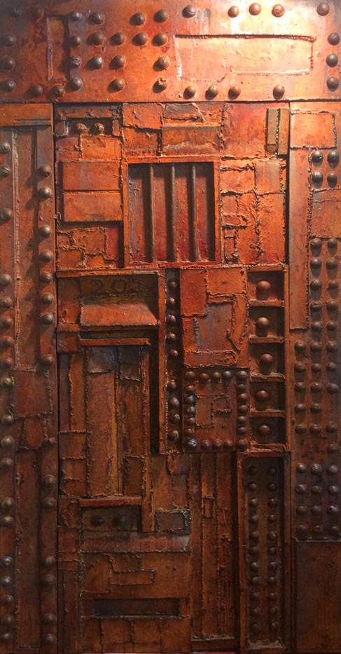 Distressed metal door created to entrance of nightclub in Manchester, England.