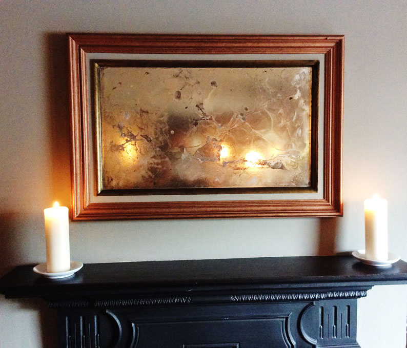 Distressed copper and brass framed artwork with antique mirror glass manufactured and designed by Devlin In Design.