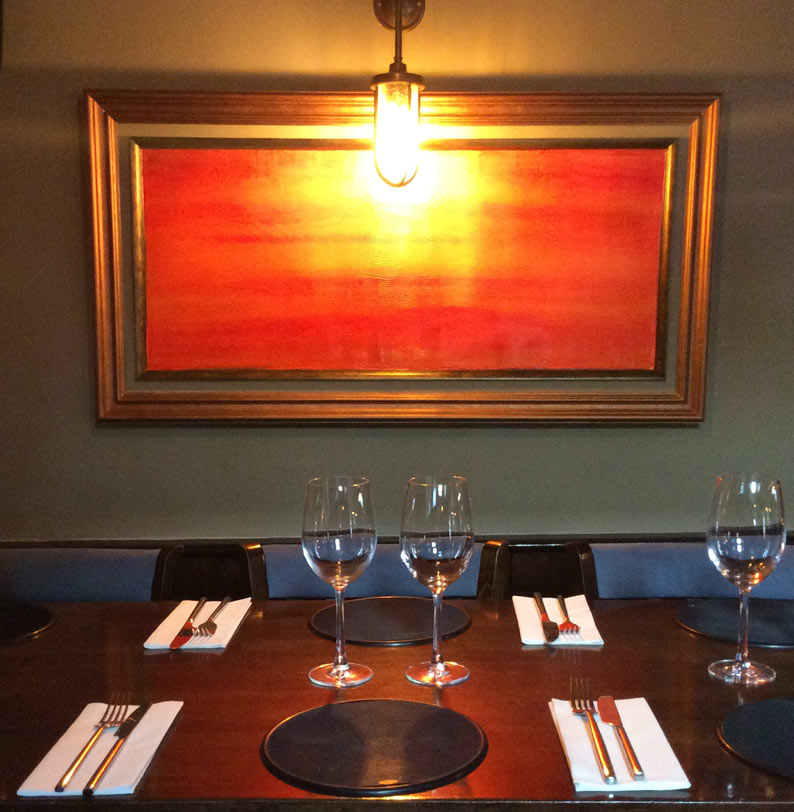 Copper framed rerstaurant artwork.