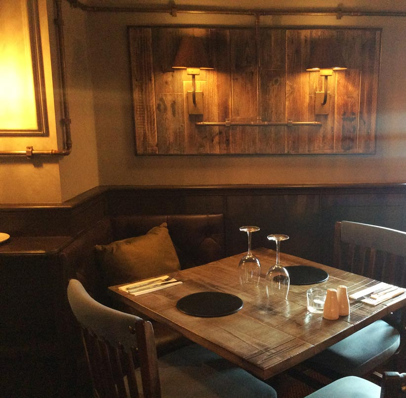 Rustic vintage restaurant tables manufactured and framed artwork for Brewers House Restaurant.