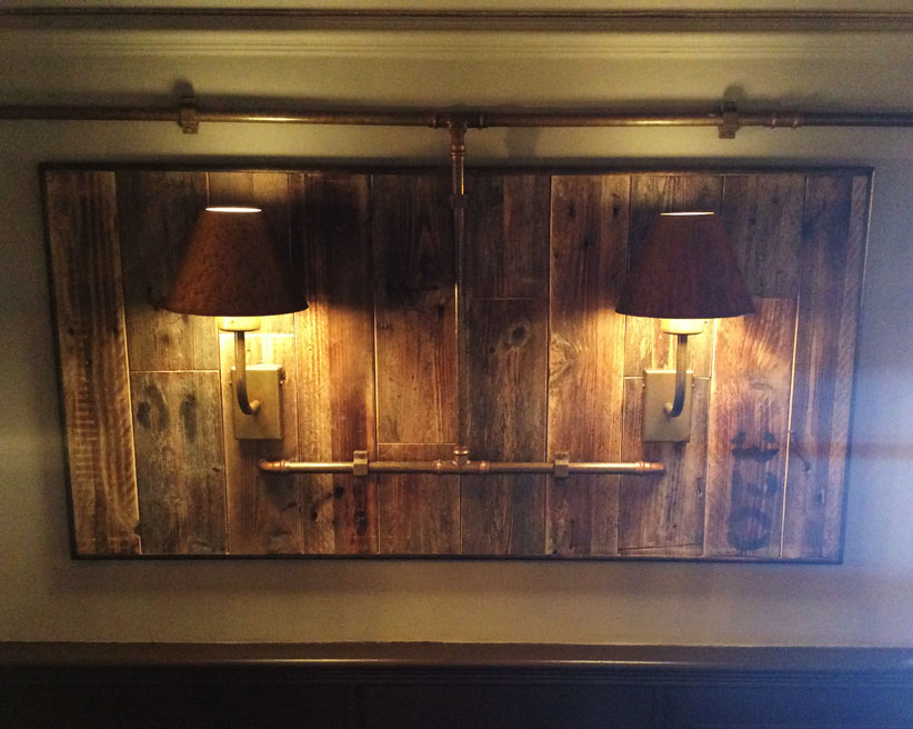 Distressed wooden framed artwork with vintage lighting manufactured for the Brewers House Restaurant.