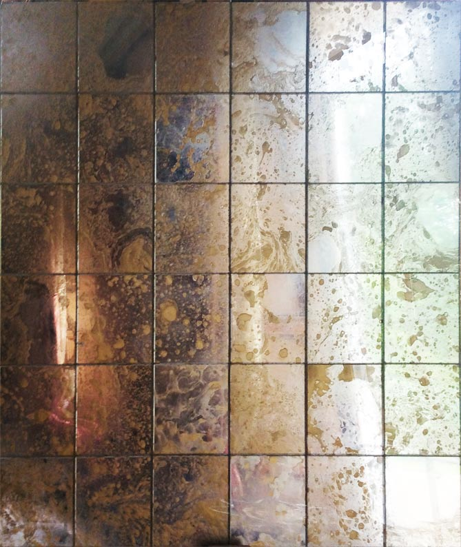 Marbled antique foxed mirror glass tiles for restaurant interior designed and manufactured by Devlin In Design.