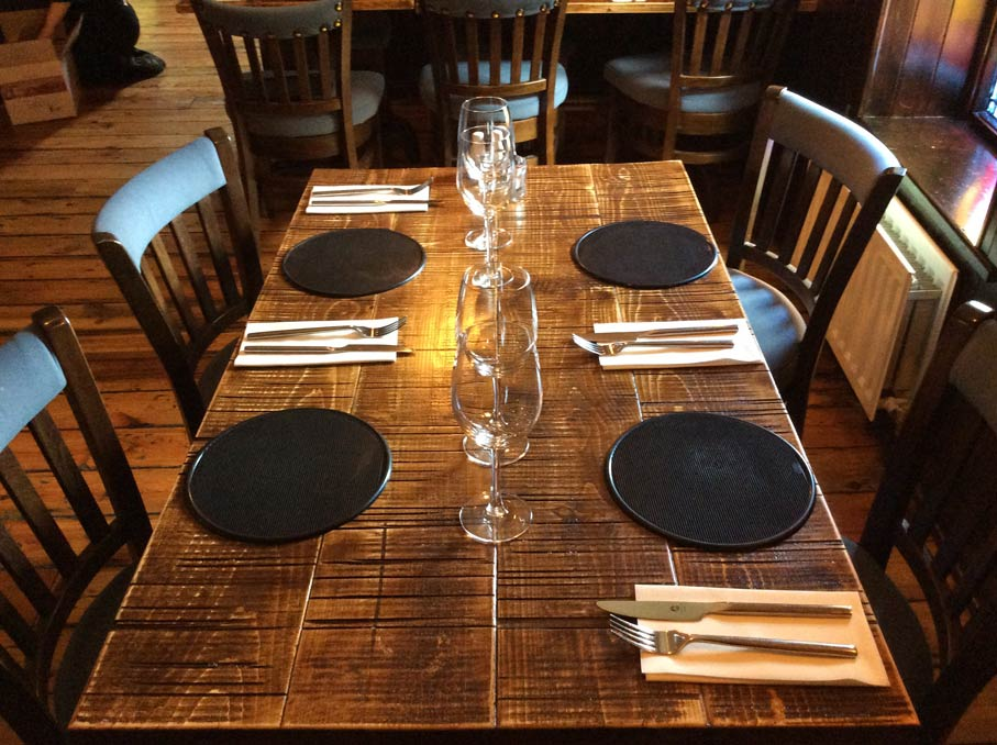 Vintage and rustic restaurant tables hand built and manufactured by Devlin In Design.