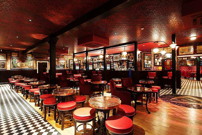 Harp Bar ceilings Belfast faux finish and red leather effect