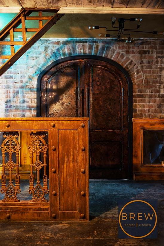 Ornate crafted rust feature panels and decorative painted doors.